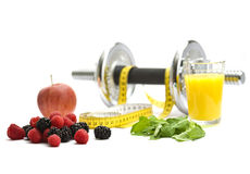 Recreation ingredients. Dumbell and measuring tape with refreshments Stock Image