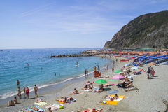 Recreation at Monterosso al Mare Beach. MONTEROSSO,LIGURIA, ITALY - JUNE 26, 2015. Monterosso al Mare Beach ,town in famous Cinque Terre, comune in the province Stock Photography