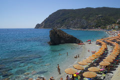 Recreation at Monterosso al Mare Beach. MONTEROSSO,LIGURIA, ITALY - JUNE 26, 2015. Monterosso al Mare Beach ,town in famous Cinque Terre, comune in the province Royalty Free Stock Image