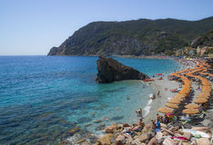 Recreation at Monterosso al Mare Beach. MONTEROSSO,LIGURIA, ITALY - JUNE 26, 2015. Monterosso al Mare Beach ,town in famous Cinque Terre, comune in the province Royalty Free Stock Images