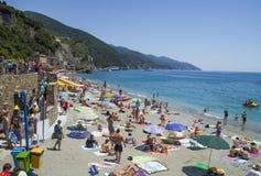 Recreation at Monterosso al Mare Beach. MONTEROSSO,LIGURIA, ITALY - JUNE 26, 2015. Monterosso al Mare Beach ,town in famous Cinque Terre, comune in the province Royalty Free Stock Photo