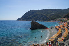 Recreation at Monterosso al Mare Beach. MONTEROSSO,LIGURIA, ITALY - JUNE 26, 2015. Monterosso al Mare Beach ,town in famous Cinque Terre, comune in the province Royalty Free Stock Photography