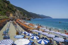 Recreation at Monterosso al Mare Beach. Monterosso al Mare Beach ,town in famous Cinque Terre, comune in the province of La Spezia, Italy Royalty Free Stock Photos