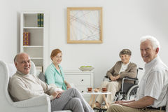 Recreation room with seniors. Recreation room at nursing home with seniors Stock Photo