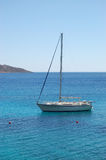 Recreation sail yacht at the beach of luxury hotel. Crete, Greece Royalty Free Stock Images