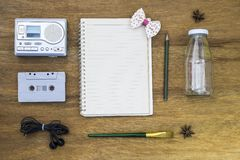 Recreation set top view with blank paper and cassette player Stock Photography