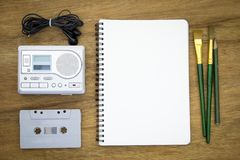 Recreation set top view with blank paper and cassette player Stock Photos