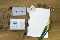 Recreation set top view with blank paper and cassette player Stock Images
