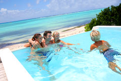 Recreation time in pool. Parents and kids in swimming pool Royalty Free Stock Photography