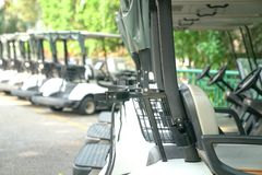 Golf carts parked outdoor. Recreation or transport concept : Golf carts parked outside a golf club stock photos
