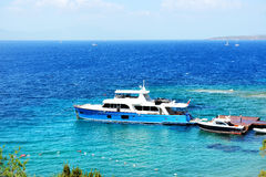 Recreation yacht at the pier on Turkish resort Royalty Free Stock Photo