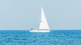 Recreation yacht, ship sailing on Black Sea, blue water, sunny day and clear sky. Royalty Free Stock Image
