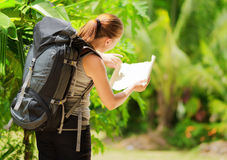 Young woman with backpack in a woods Stock Photos
