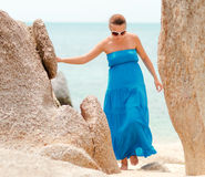Young woman on a rocky beach Stock Photos
