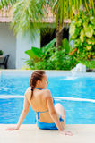 Young woman in a swimming pool Stock Photos