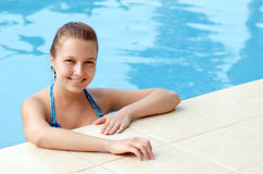 Young woman in a swimming pool Stock Photo