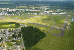 Recreational Airport in Rural Area. Lush green airport on partially cloudy day Stock Image