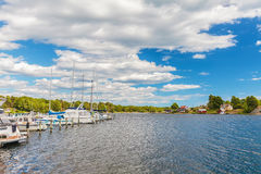 Recreational boats in front of a small swedish island with old w Royalty Free Stock Images