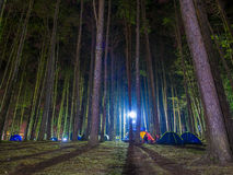 Recreational camping tents with silhouetted of the alpine trees Stock Image