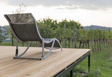 Recreational empty deck chair with mediterranean vineyards Stock Photos