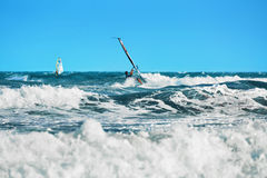 Recreational Extreme Water Sports. Windsurfing. Surfing Wind Act. Recreational Water Sports. Windsurfing. Windsurfer Surfing The Wind On Waves In Ocean, Sea stock photo