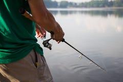 Recreational fishing at a serene lake Stock Photography
