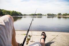 Recreational fishing at a serene lake Stock Image