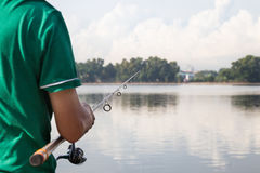 Recreational fishing at a serene lake Stock Images
