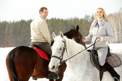 Recreational horseback riding. Portrait of happy family horseback riding in winter stock photos