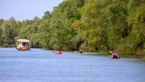 Recreational Kayaking-Canoeing on Danube Delta adventure in Romania wildlife.  stock photo