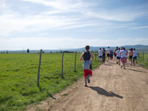 Recreational marathon race through fields and meadows Stock Photo