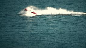 Recreational high speed motorboat makes sudden turn at sea. Recreational motorboat makes sudden turn royalty free stock photos