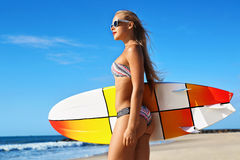 Recreational Summer Water Sports. Surfing. Girl Holding Surfboard Stock Photos