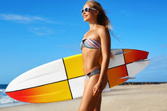 Recreational Summer Water Sports. Surfing. Girl Holding Surfboard Royalty Free Stock Photo