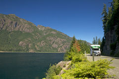 Recreational Vehicle. Driving on road next to a lake in British Columbia Stock Photo