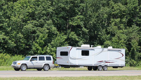 Recreational vehicle being towed along a U.S. interstate highway. Stock Photo