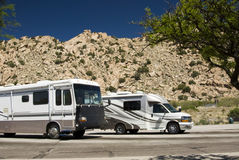Recreational vehicles. Parked at an interstate rest area in Arizona Stock Photos