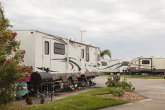 Recreational vehicles at a campsite Royalty Free Stock Photos