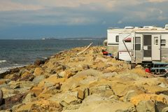 Recreational vehicles on the shore of the rocky beaches of Faria Beach National Park, California. royalty free stock images