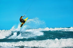 Recreational Water Sports Action. Kiteboarding Extreme Sport. Su. Recreational Water Sports Action. Healthy Man ( Surfer ) Kiteboarding ( Kite Surfing ) On Waves Royalty Free Stock Photo