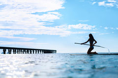 Recreational Water Sports. Woman Silhouette On Surfboard In Ocea Royalty Free Stock Photography