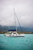 Recreational Yacht in fog at the coast of Seychelles Royalty Free Stock Photos