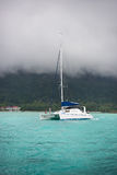 Recreational Yacht in fog at the coast of Seychelles Stock Images