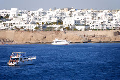 Recreational yachts near Red Sea reef Royalty Free Stock Images