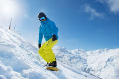 Recreative vacation at a ski resort. Snowboarder enjoying snow in the mountains stock photo
