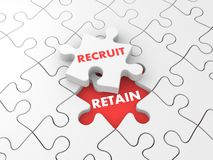 Recruit and retain. Business metaphor with puzzles Stock Photo