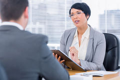 Recruiter checking the candidate during a job interview Stock Images