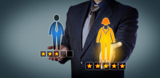 Recruiter Rating Female Employee With Five Stars. Blue chip recruiting executive preferring a female employee with a five star rating over a male worker with Stock Photos
