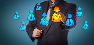 Recruiter Selecting Female Employee Icon. Blue chip recruitment consultant selecting a female employee in a group of white collar worker icons. Business concept Royalty Free Stock Photo