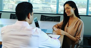 Recruiter taking interview of female candidate. In office stock footage